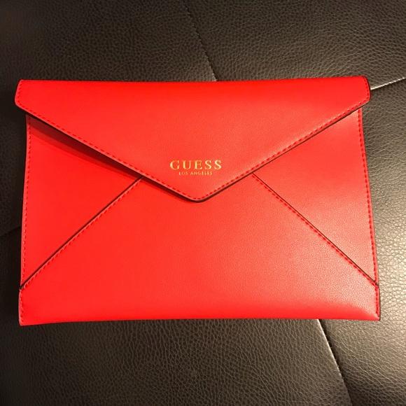 f109a3a5da36 Guess Handbags - NWT GUESS red clutch